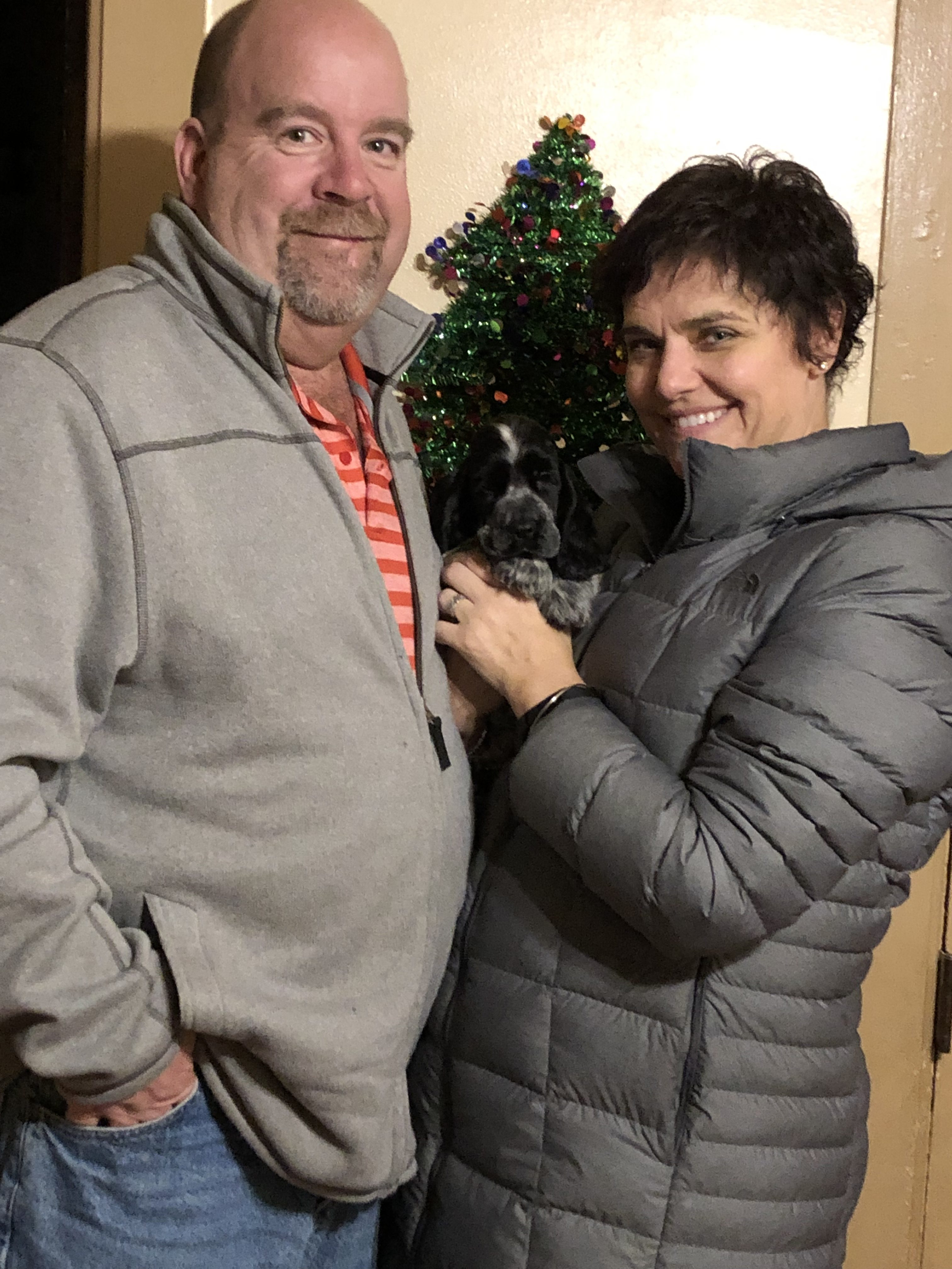 Cain and his new family--Sue Schmidt and Mike Bielski